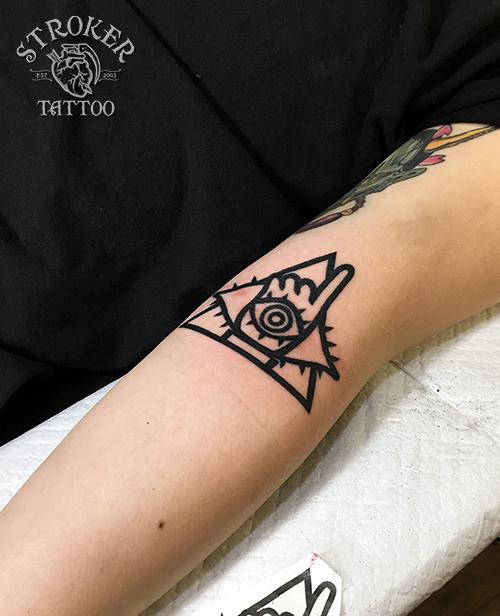 21世紀少年、目のタトゥー